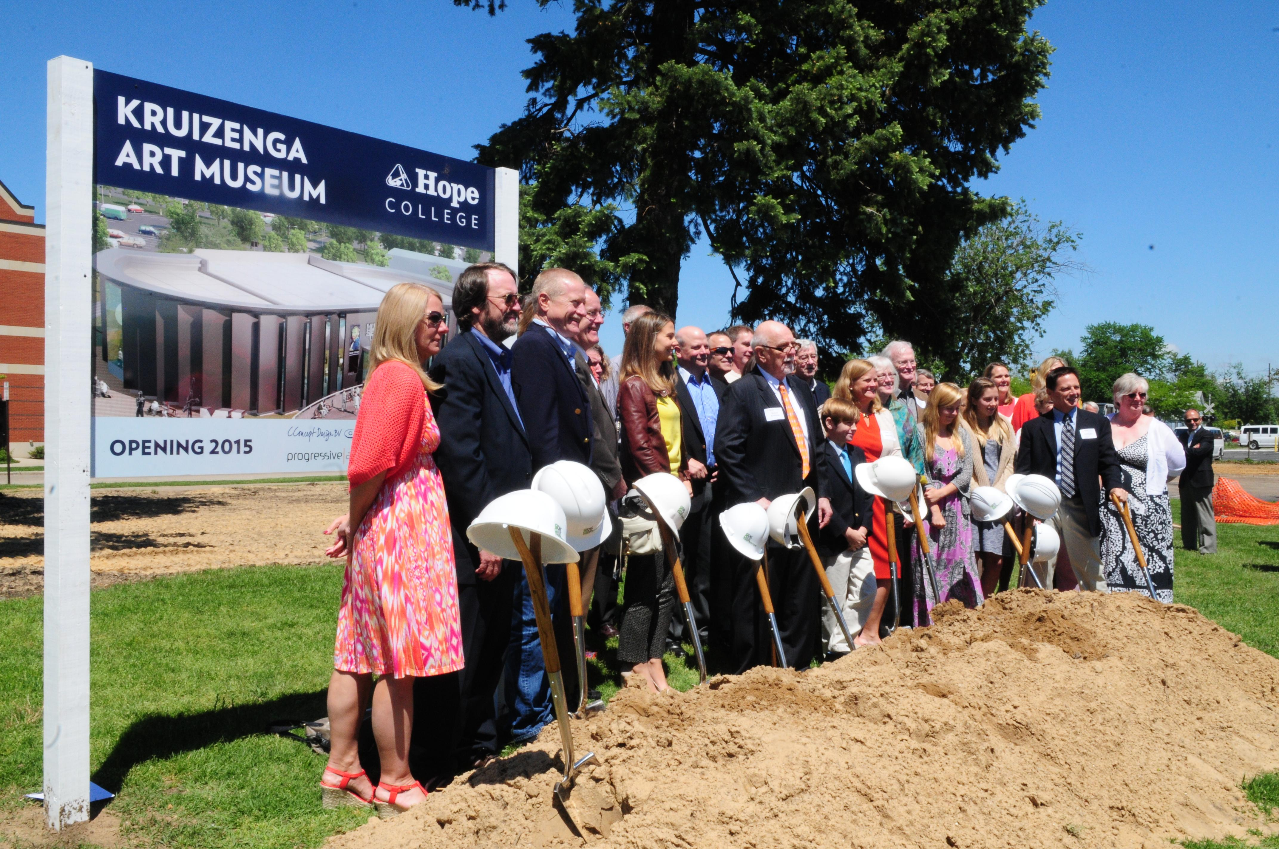 People gathered around the shovels for the groundbreaking.