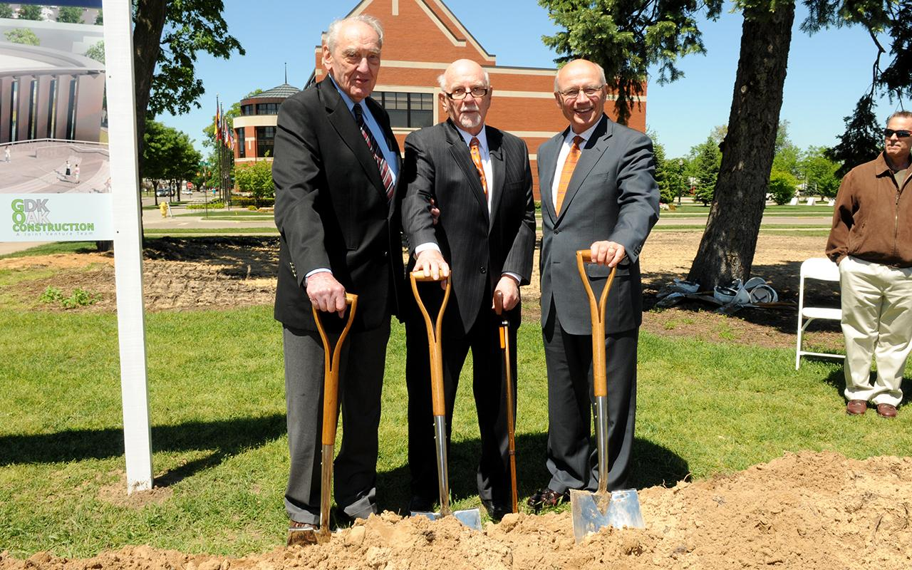 President Emeritus Gordon Van Wylan, Dr. Richard Kruizenga and President Emeritus James Bultman with shovels in the ground.