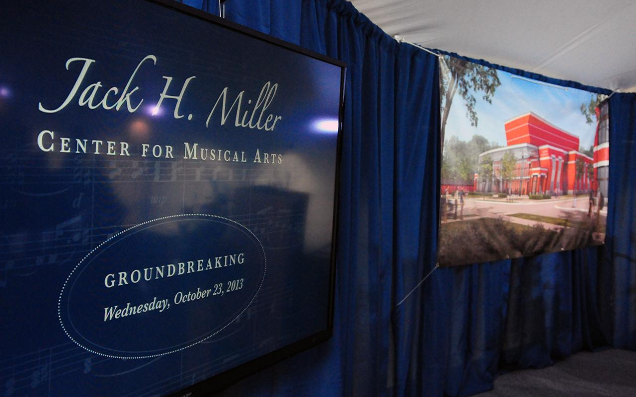 A sign that for the Jack H. Miller Center for Musical Arts next to a conceptual rendering of the building.