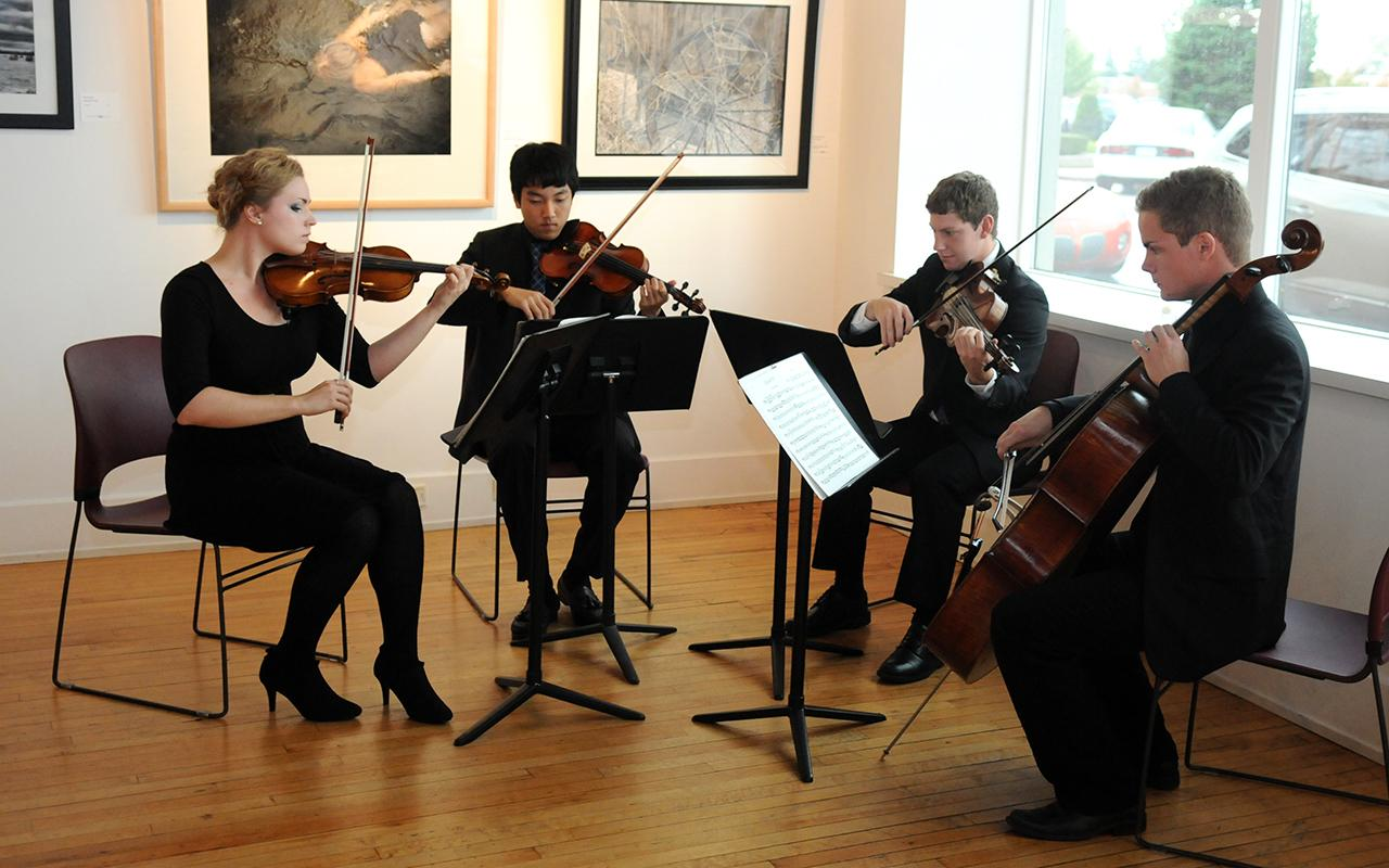 A string quartet playing.