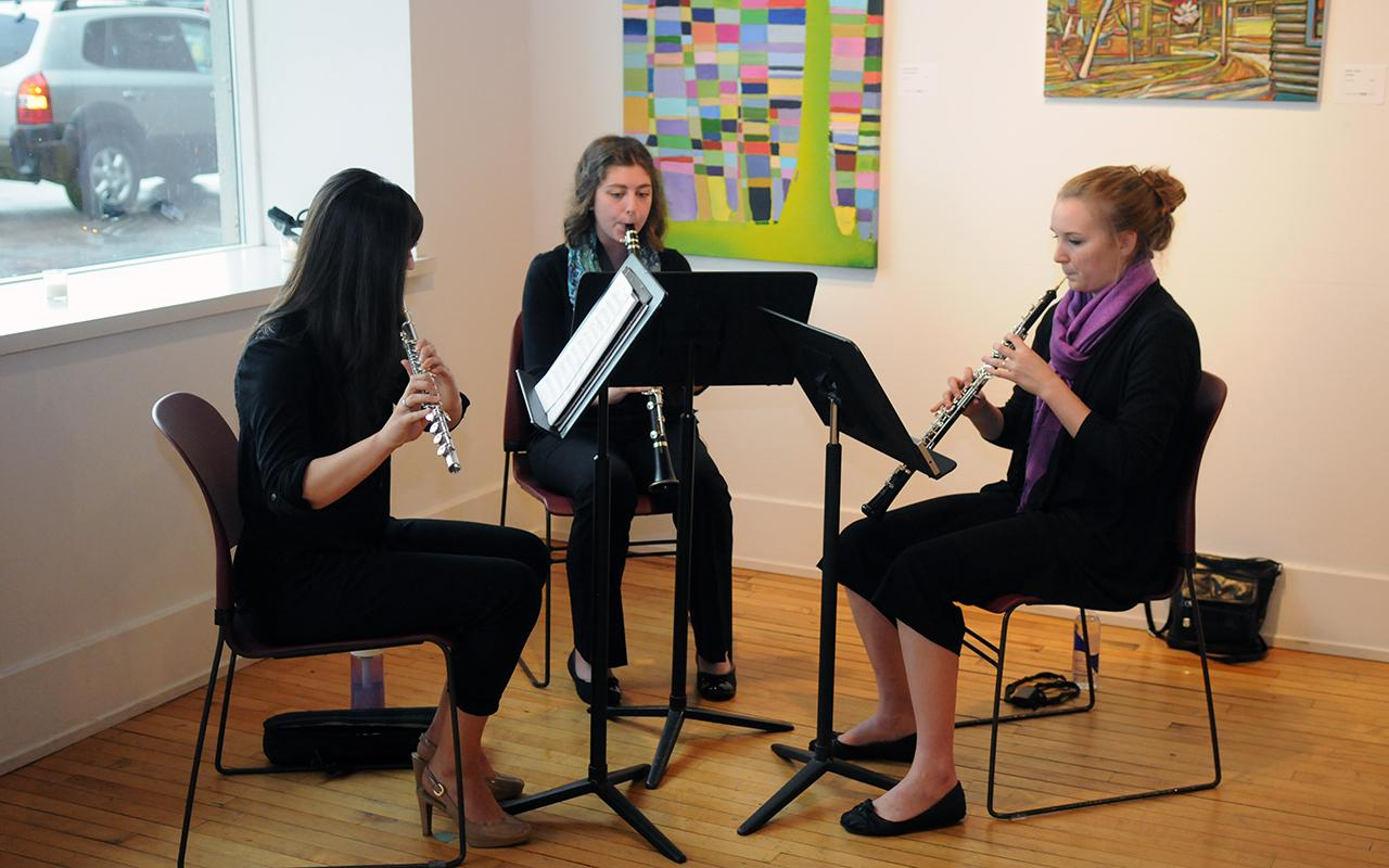 A woodwind trio playing.