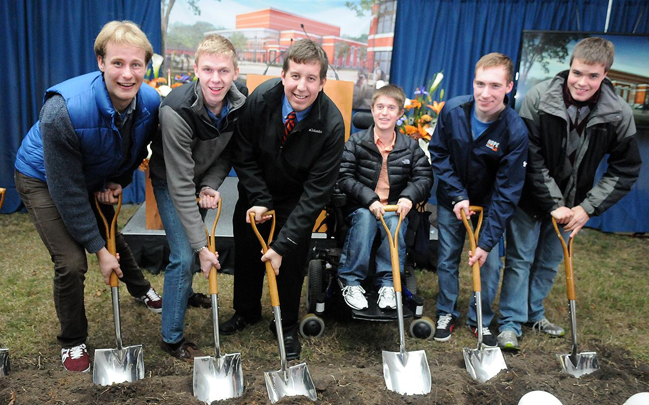 Hope students Joshua McCammon, Matthew Milliken, Aaron Goodyke, Colin Rensch, David Heinze and John Deppe pose with shovels.