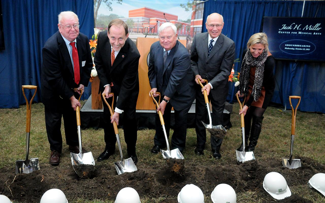 David Roossien, President John Knapp, Jack Miller, President Emeritus James Bultman and Cheri DeVos digging into the dirt.
