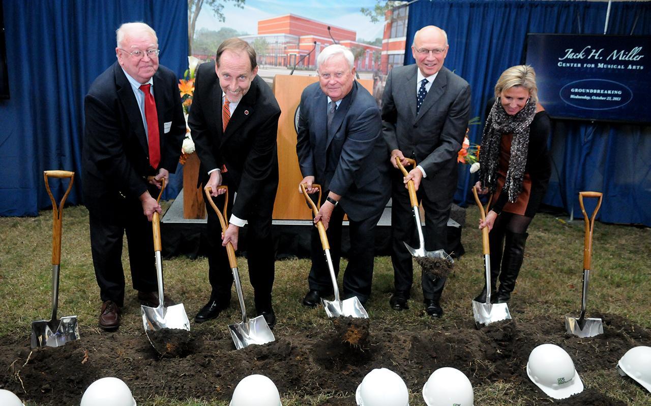 David Roossien, President John Knapp, Jack Miller, President Emeritus James Bultman and Cheri DeVos digging into the dirt.
