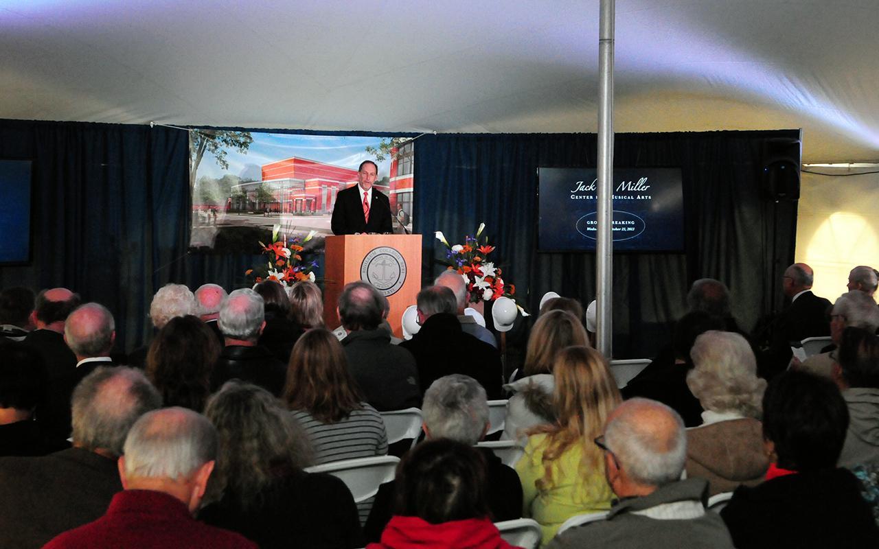 President John Knapp addresses the audience from the podium.