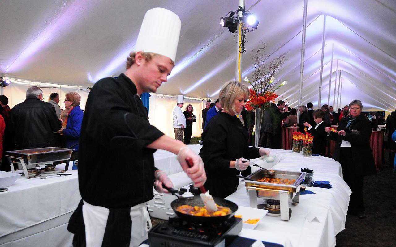 A chef preparing food inside the tent.