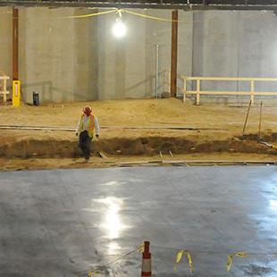 Inside the auditorium as the floor is being completed.