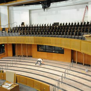 The auditorium seats are being installed in the balcony.