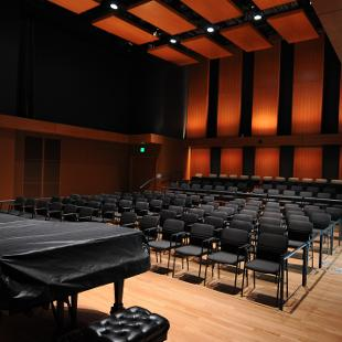 The Dede and John Howard Recital Hall showing the piano and seating.