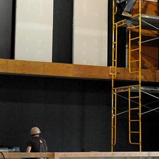 Walls in the auditorium are made black.