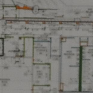A shot of the blueprints to the building.