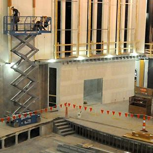 A view of the auditorium as it is being worked on from the top level looking down.