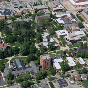 Aerial view of central campus showing Nykerk Hall of Music and the future site of the Jim and Martie Bultman Student Center. Photo by Tom Renner on June 3, 2015