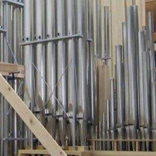 The organ being built in a modeling room.