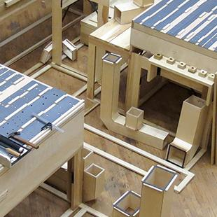 The wooden pieces of the concert organ being prepared for the pipes.