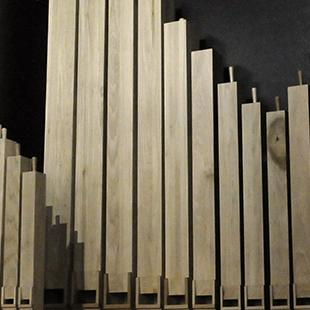 The first set of organ pipes in place.