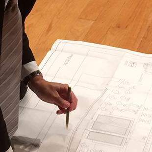 Simon Couture, Vice President of Casavant Frères, draws on the plans for the organ on the ground.