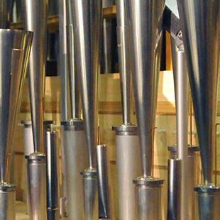 A close-up of organ pipes.
