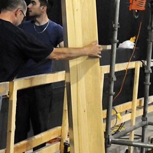 The first organ pipes being placed in the auditorium.