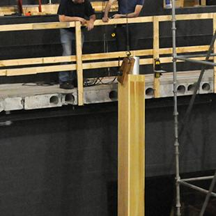 Workers placing the first organ pipes.