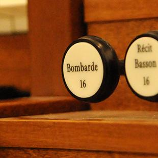 A close-up of the organ console controls.
