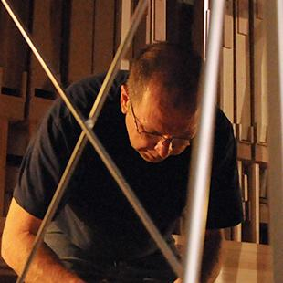A man working on assembling the pipes.