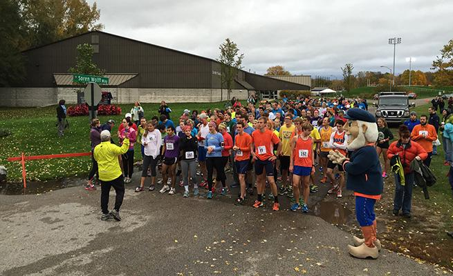 Runners gather in front of DeWitt Tennis Center for the start of the 5K race.