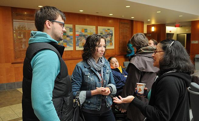 People conversing in the A. Paul Schaap Science Center atrium.