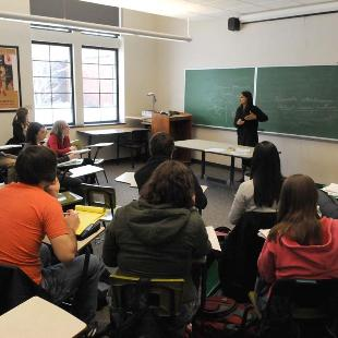 Students listen to a professor in a classroom of Lubbers Hall