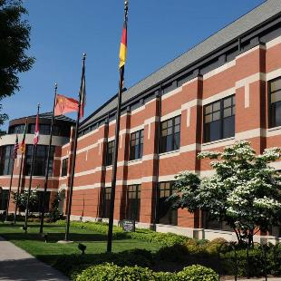 International flags fly outside the Martha Miller Center