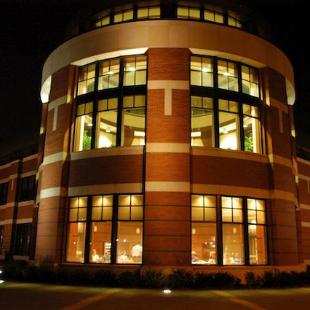 The Martha Miller Center is brightly lit at night