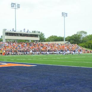 The Hope College football team plays a game in the Ray and Sue Smith Stadium