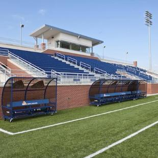 Team and spectator seating at the Van Andel Soccer Stadium