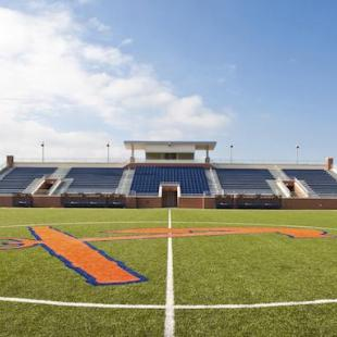 The orange and blue anchor at the center of the soccer field