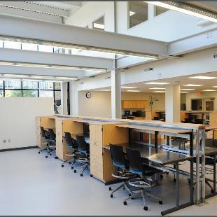 Empty desks in the Haworth Engineering Center in VanderWerf Hall