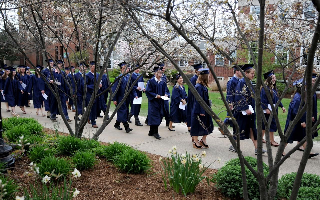 The second group of seniors process along 12th Street from the DeWitt Center to Dimnent Memorial Chapel prior to  the Baccalaureate Service.
