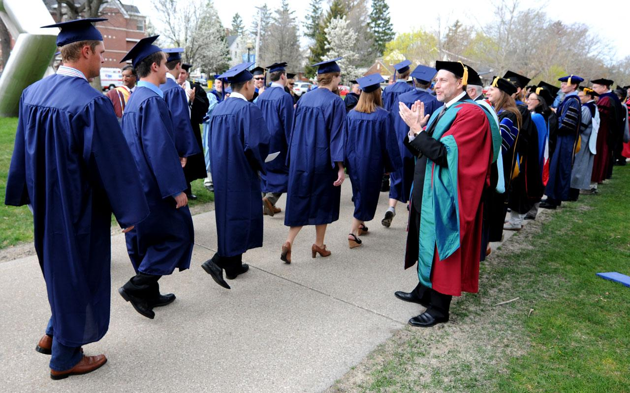 Faculty applaud seniors entering Dimnent Memorial Chapel prior to the Baccalaureate Service.