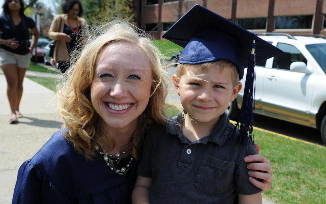 Female graduate with young boy after  the Baccalaureate Service.