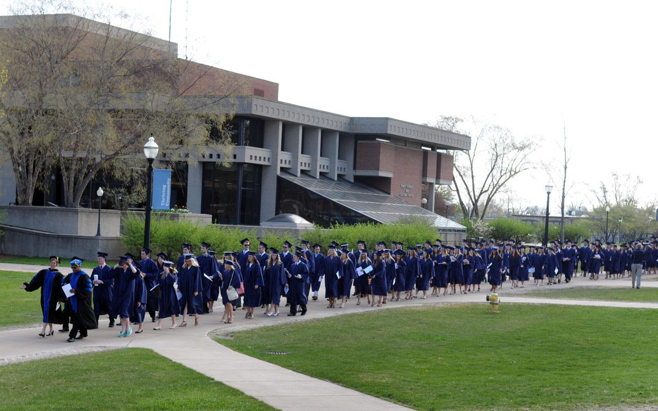 The first group of seniors process along 12th Street from the DeWitt Center to Dimnent Memorial Chapel prior to  the Baccalaureate Service.