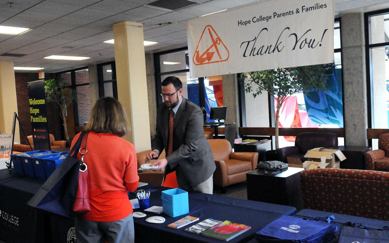 Alumni Director Scott Travis staffs the resource center in the lobby of the DeWitt Center.