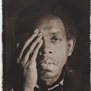 A 1999 photographic print by Rashid Johnson (born 1977), an important young African-American artist whose work addresses issues of class, race and history. George is based on a portrait of a homeless man that Johnson took while he was still an undergraduate and that helped launch his career after it was shown at Harlem's Studio Museum in 2001.