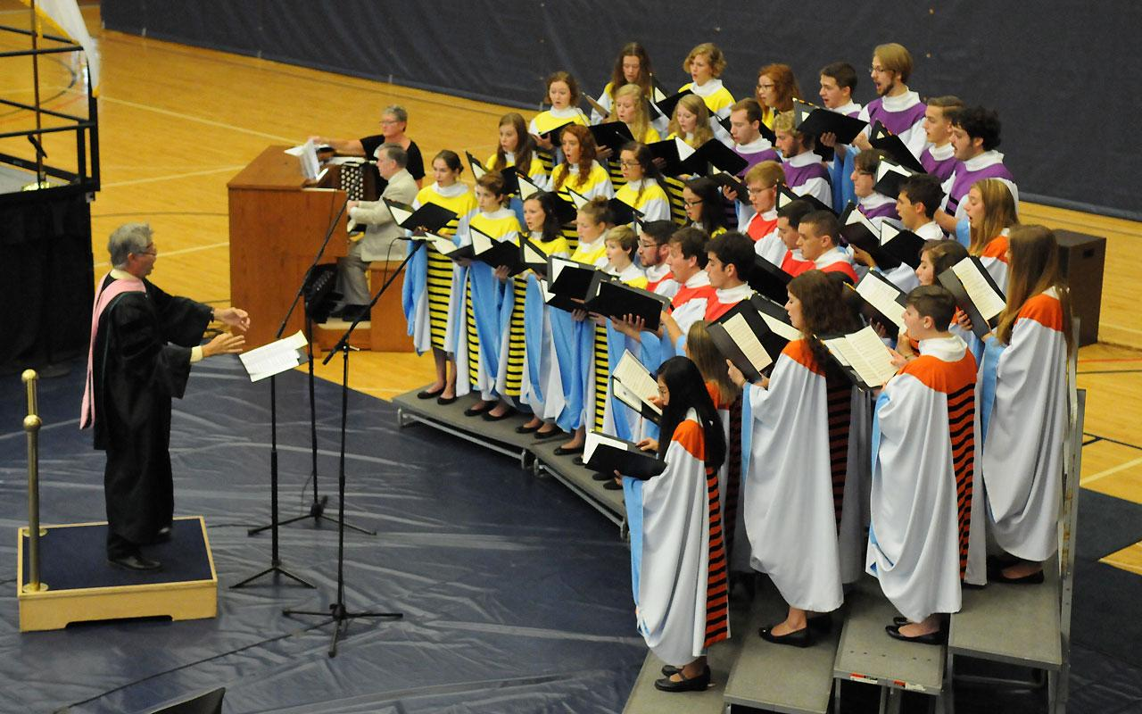 The Chapel Choir performs during the Opening Convocation in the Richard and Helen DeVos Fieldhouse.