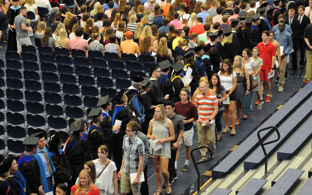 New students and faculty members process into the Richard and Helen DeVos Fieldhouse for the Opening Convocation.