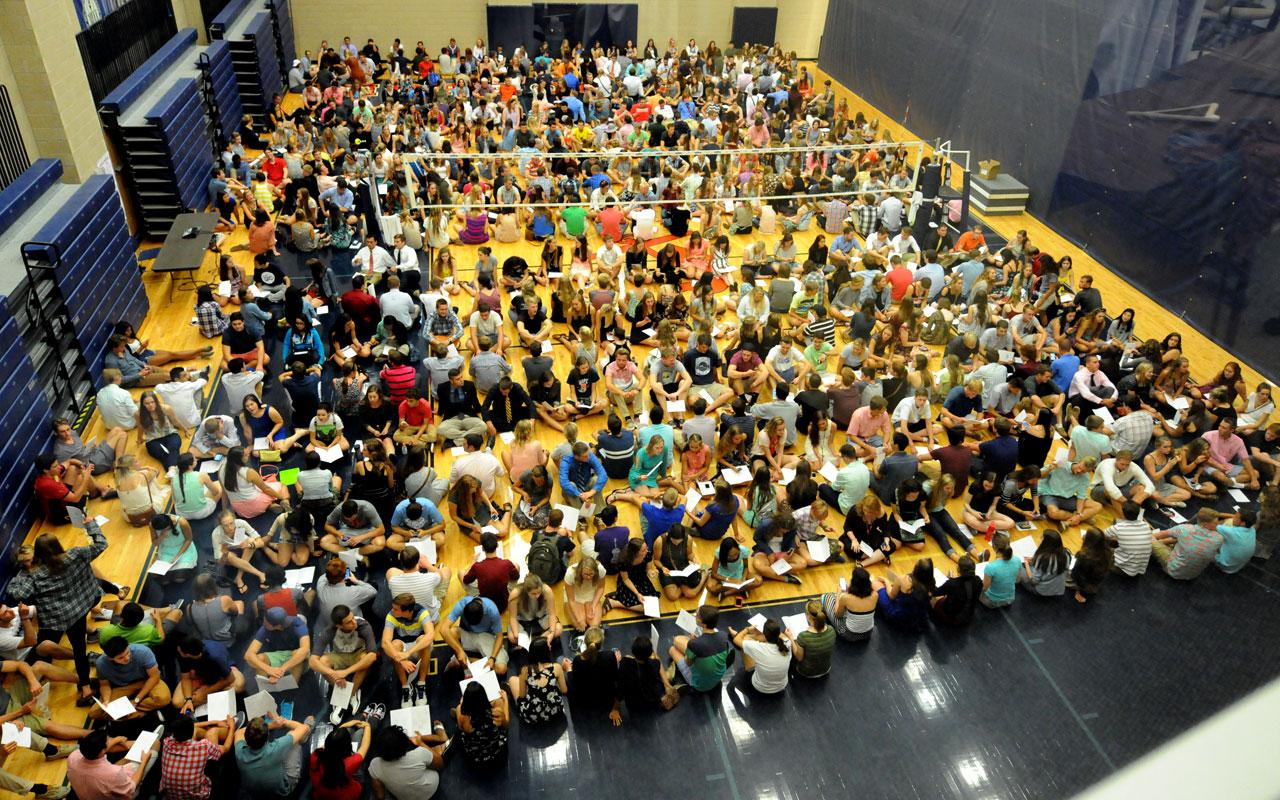 New students gather on the Volleyball Court in the Richard and Helen DeVos Fieldhouse prior to Opening Convocation.