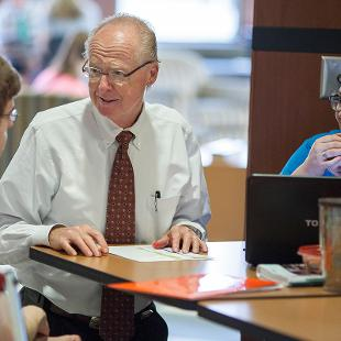 Faculty advising new students. Photo taken by Steven Herppich on August 29, 2015