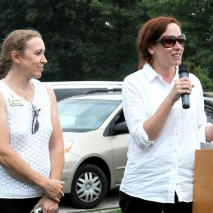 Jennifer Fellinger and Alisa Crawford speaking at microphone