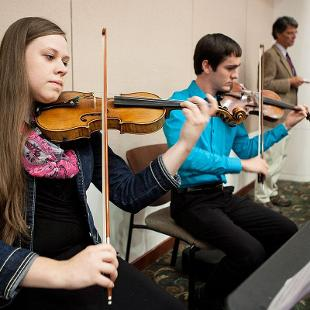 Student musicians perform during  Presidential Colloquium reception. Photo by Steven Herppich on September 30, 2015