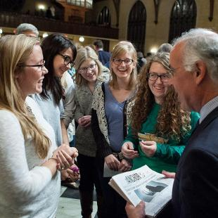 Staff members of student newspaper interact with David Brooks following his address. Photo by Steven Herppich on September 30, 2015