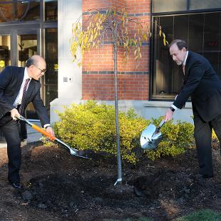 Meiji Gakuin University of Japan and Hope marked their 50-year friendship with the planting of a Kwanzan cherry tree near the southwest entrance to the Martha Miller Center for Global Communication. Pictured are Hiroyoshi Udono, president of Meiji Gakuin, and John Knapp, president of Hope College. Photo by Tom Renner on November 4, 2015