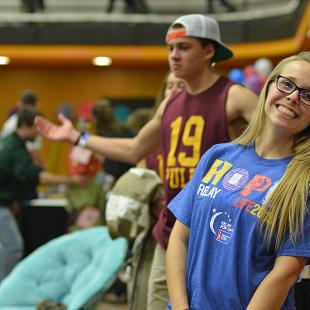 Students play games during the Relay for Life campus event in the Dow Center gym.